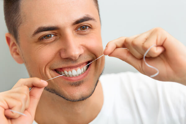 floss with lingual braces